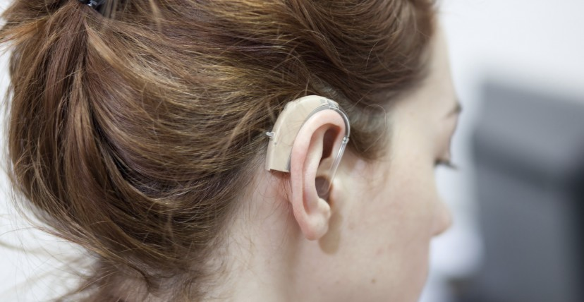 A lady with a hearing aid in her right ear